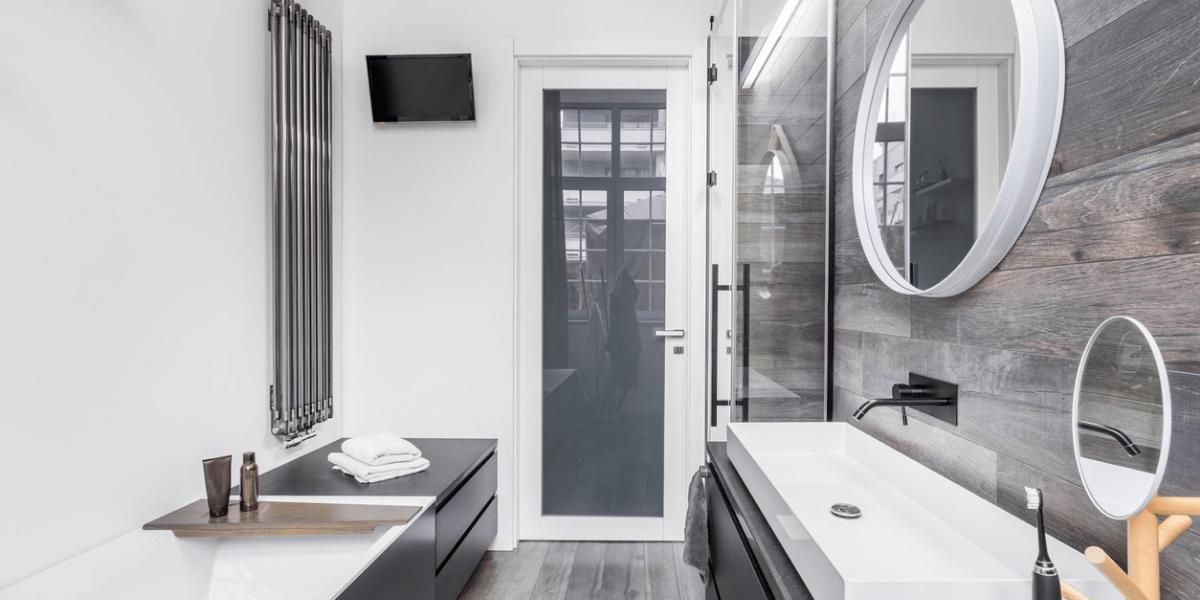 modern white bathroom with wood paneled walls and good grain floor - small bathroom makeovers